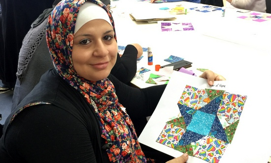 Former refugee with quilt square