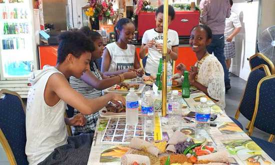 Ethiopian youth enjoy cultural food